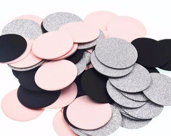 100 pieces large confetti in pink, silver and black.