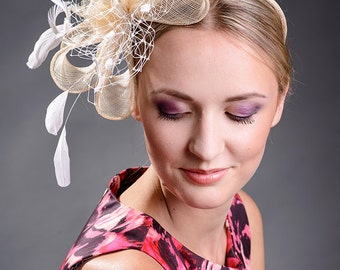 Beige fascinator  with  veil and feathers