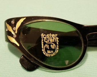 Beautiful, vintage 50's 60's, deadstock, Foster Grant, cat eye sunglasses with gold accents and rhinestones!