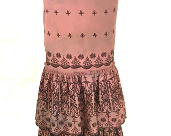 Pink fishtail skirt with black embroidery