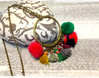 Bronze necklace with pendant circles and colorful pom-poms