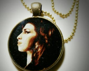 Pendant with 24 inch ball chain. Brass. Amy Winehouse pop art portrait by artist,Fred Larucci.