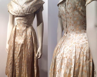 Stunning 1950s brocade shawl collar dress. Excellent condition.