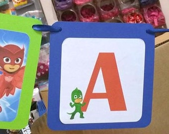 Festoon PJ Masks Superpajamas in cardboard with written your name and with tape included