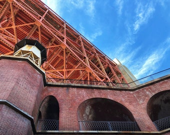 Looking up at the Golden Gate Bridge. Fort Point, San Francisco, CA