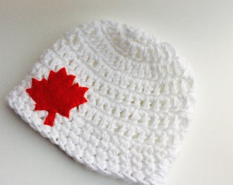 Cotton beanie with red maple leaf applique in white for newborn baby