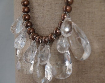 free spirit flowy clear briolette with copper beads on light grey cotton jersey