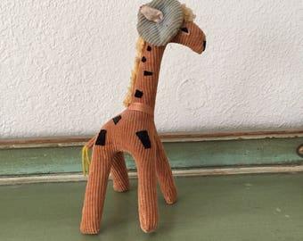 Charming vintage 1950s beret wearing giraffe toy
