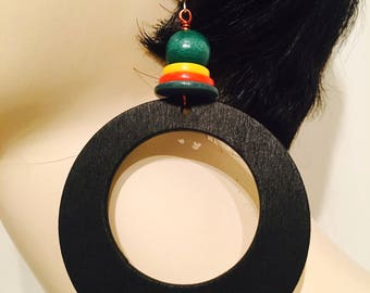 Handmade wood and button hoop earrings jewelry accessory.