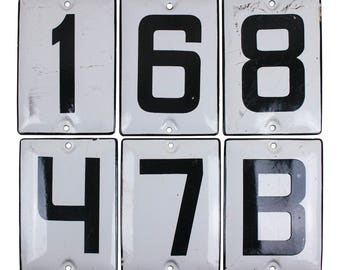Enamel signs with numbers and cyrillic letters