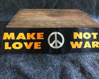 Vintage fluorescent Make Love Not War bumper sticker