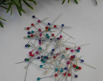 80 pins with multi-colored beads