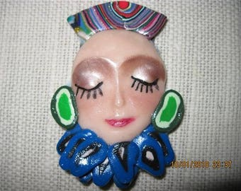 Ladyface Clay Magnet...Glamour Girl with blue feathers