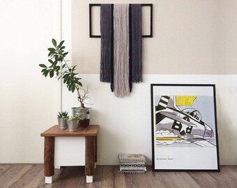textile wall hanging with yarn wrapped frame | contemporary fiber art |  textile wall art | gray and black yarn | geometric tapestry