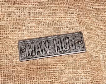 "The ""Man Hut"" Cast Iron Plaque"