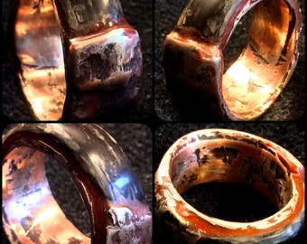 Earth Fire and Ice , man's wedding ring.