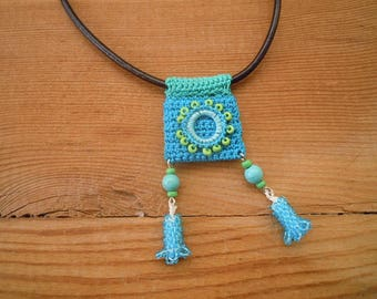 turquoise crochet pedant, leather cord