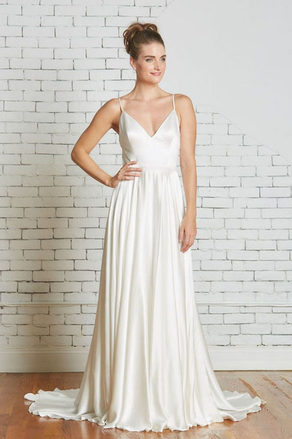 Silk Charmeuse Wedding Gown with a Strappy Low Back Flowing