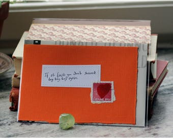 If at first you don't succeed, try, try, try again Orange card with handwritten quote and Swedish heart postal stamp
