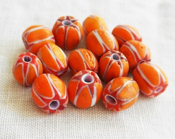 Lot of 25 orange and  red and white striped chevron glass Beads 6 x 7mm  C4401
