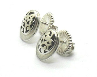 Lois Hill .925 silver cutout and sandblasted silver oval shape. pierced earrings.