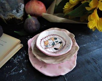 Tris of irregular ceramic saucers hand-moulded