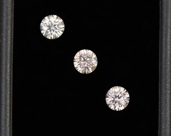 Beautiful Silvery Champagne Zircon Gemstone Set, Concave Round Cut, 2.40 tcw., 5 mm.