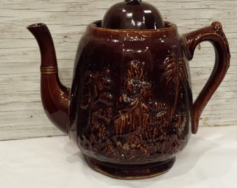 "Vintage late 19th Century Rockingham Teapot known as ""Rebecca at the Well"""