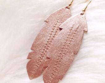 feather earrings made with pink gold leather