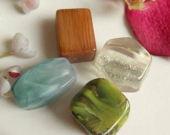 set of 4 plastic beads