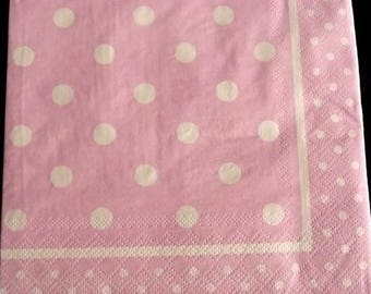 Light pink background with white polka dots paper towel