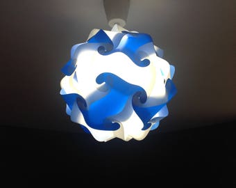 Light blue and white lamp sphere puzzle