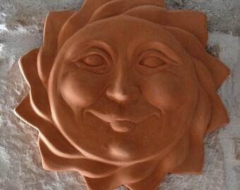 Wall decoration. Sun relief. Terracotta Sun