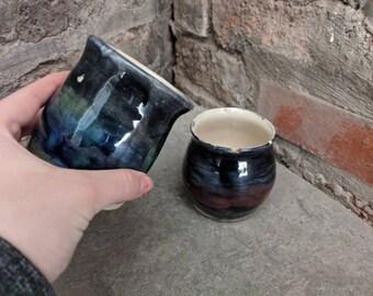 Mug and milk jug with range of colours