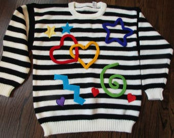 1980's acrylic ladies wacky fun over sized sweater black and white striped with designs size large