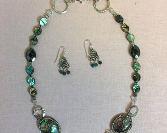 Single strand necklace with pewter focal element, abalone, and hematite