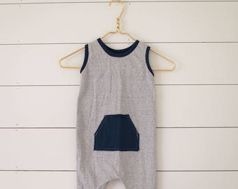 Tank romper with navy pockets on black and white stripe by Little Lapsi