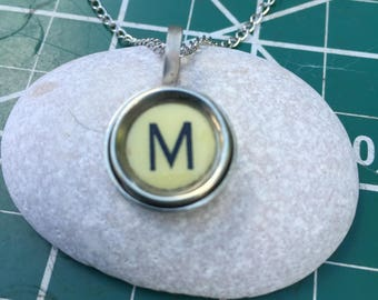 M Typewriter key pendant. Black on off white