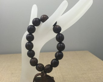 Wood beaded bracelet with Burnt Horn cross