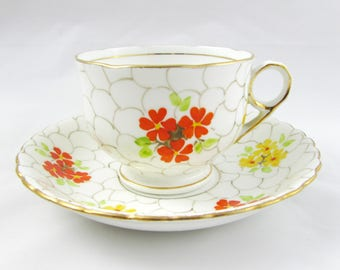 Vintage Tea Cup and Saucer by Phoenix China with Hand Painted Orange and Yellow Flowers, Art Deco, Bone China