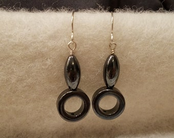 Dangle earrings featuring simple Hematite shapes on sterling silver ear wires
