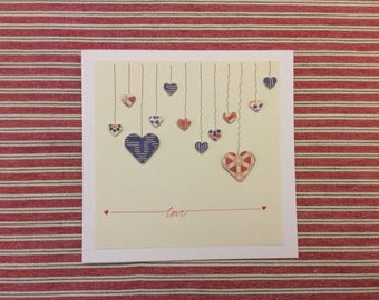 Hang on to your Hearts handcrafted  greeting card.  Simple lines of hanging hearts will say 'I cherish you' to the one you love.