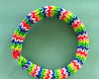 """BEST SELLER,  """"Fiesta"""" 7"""", a 6 Point Hexafish Bracelet Using Blues, Greens, Red, Pink, Yellow, and White Rainbow Loom Bands.  A Beauty!"""