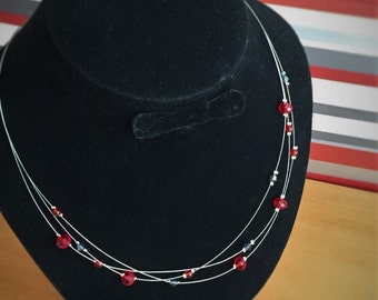Layered delicate ruby coloured minimalist beaded necklace, modern red floating necklace