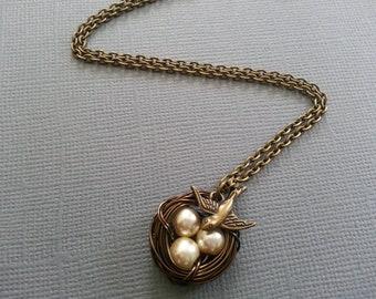 Butter cream Bird's Nest Necklace in Antique Brass