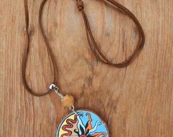 Sunburst wood slice pendant hand painted slip knotted leather cord