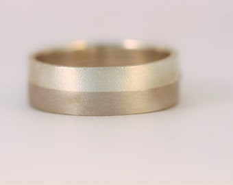 Two shades of grey ... palladium and sterling silver wedding band.