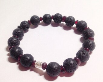 Blaze. Natural Lava Stone and Garnet bracelet with pure silver bead.