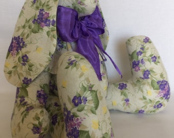 Handmade bunny made from purple and lilac forget me not looking flowers