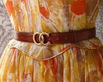 vintage 1970s Oleg Cassini belt <> 70s brown lizard skin Oleg Cassini thin belt <> reptile Oleg Cassini belt with gold OC buckle.